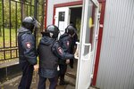 Police officers enter the Perm State University in Perm, about 1,100 kilometers (700 miles) east of Moscow, Russia, Monday, Sept. 20, 2021. Officials say a gunman has opened fire at a university in Russia, leaving around eight people dead and over 20 injured. The Interior Ministry said the gunman was detained after Monday's shooting at Perm State University. (AP Photo/Anastasia Yakovleva)