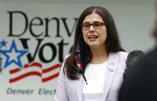 Colorado Secretary of State Jena Griswold makes a point during a news conference at a mobile voting location in the Swansea neighborhood, Tuesday, June 30, 2020, in Denver. (AP Photo/David Zalubowski)