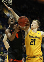 Oregon State's Alfred Hollins, left, shoots against California's Lars Thiemann (21) in the second half of an NCAA college basketball game Saturday, Feb. 1, 2020, in Berkeley, Calif. (AP Photo/Ben Margot)