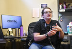 Community Crime Impact Team Mental Health Responder Kenzie Janson-Wolle, ldescribes her role during an interview Monday, July 13, 2020, at the St. Cloud, Minn., Police Department. (Dave Schwarz/The St. Cloud Times via AP)