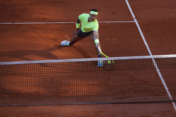 FILE- In this Friday May 31, 2019, image Spain's Rafael Nadal plays a shot against Belgium's David Goffin during their third round match of the French Open tennis tournament at the Roland Garros stadium in Paris.  Sliding is one of the keys to success at the French Open, with the ability to glide along the ground to reach shots that others can't, is one of the skills that makes Rafael Nadal so successful on clay courts, although the French Open is postponed until September because of the coronavirus. (AP Photo/Michel Euler, File)