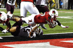 Louisville running back Hassan Hall (19) goes over Eastern Kentucky linebacker Steven Crowder (15) to score during the second half of an NCAA college football game in Louisville, Ky., Saturday, Sept. 7, 2019. (AP Photo/Timothy D. Easley)