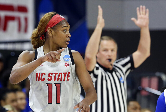 North Carolina State's Kiara Leslie (11) points to a teammate following a three-point basket against Kentucky during the first half of a second-round women's college basketball game in the NCAA Tournament in Raleigh, N.C., Monday, March 25, 2019. (AP Photo/Gerry Broome)