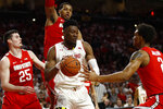 Maryland forward Bruno Fernando, center, of Angola, drives against Ohio State forward Kyle Young, from left, forward Kaleb Wesson and guard Musa Jallow in the second half of an NCAA college basketball game, Saturday, Feb. 23, 2019, in College Park, Md. Maryland won 72-62. (AP Photo/Patrick Semansky)