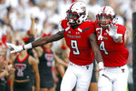 Texas Tech's T.J. Vasher (9) celebrates with Antoine Wesley (4) after scoring a touchdown during an NCAA college football game against Houston, Saturday, Sept. 15, 2018, in Lubbock, Texas. (Brad Tollefson/Lubbock Avalanche-Journal via AP)