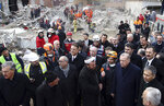 Turkey's President Recep Tayyip Erdogan speaks to people as he visits the site of a collapsed building in Istanbul, Saturday, Feb. 9, 2019. Erdogan says there are