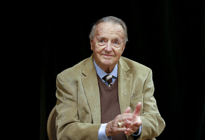 "FILE - In this Wednesday, Jan. 10, 2018, file photo, retired Florida State NCAA college football coach Bobby Bowden applauds following a Rotary Club luncheon in Omaha, Neb. Bowden, hospitalized last week after contracting COVID-19,  says he is feeling better and hopes to go home soon. Bowden, 90, told the Tallahassee Democrat on Monday, Oct. 12, 2020,""I am doing good. I appreciate everyone's thoughts, I really do.""  (AP Photo/Nati Harnik, File)"
