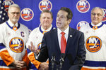 New York Governor Andrew Cuomo speaks to reporters during a news conference before an NHL hockey game between the Boston Bruins and New York Islanders, Saturday, Feb. 29, 2020, in Uniondale, NY. (AP Photo/John Minchillo)