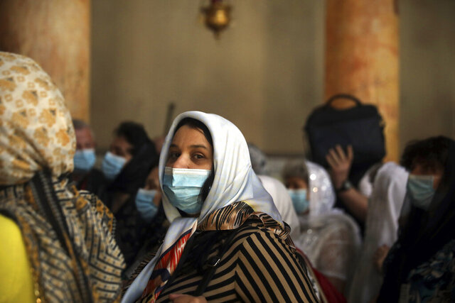 People visit the Church of the Nativity in Bethlehem, West Bank, Thursday, March 5, 2020. Palestinian authorities said the Church of the Nativity in Bethlehem, built atop the spot where Christians believe Jesus was born, will close indefinitely due to coronavirus concerns. (AP Photo/Mahmoud Illean)