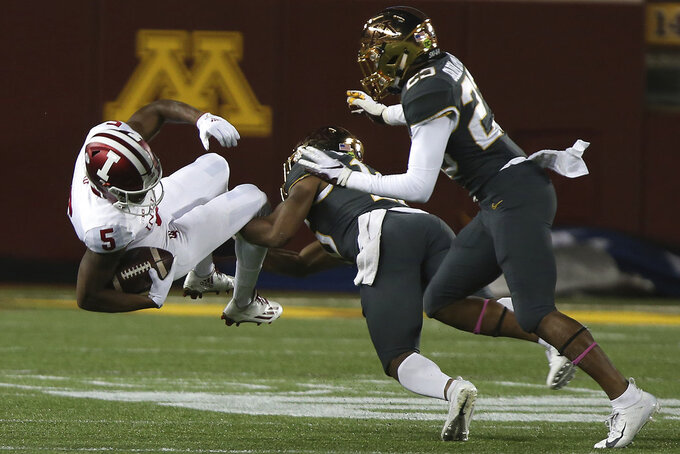 Indiana wide receiver J-Shun Harris II is tackled by Minnesota's defensive back Coney Durr during an NCAA college football game Friday, Oct. 26, 2018, in Minneapolis. (AP Photo/Stacy Bengs)