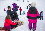 View Ridge-Madison neighborhood residents enjoy the snow where school was cancelled on Monday, Jan. 13, 2020 in Everett, Wash. (Olivia Vanni/The Herald via AP)