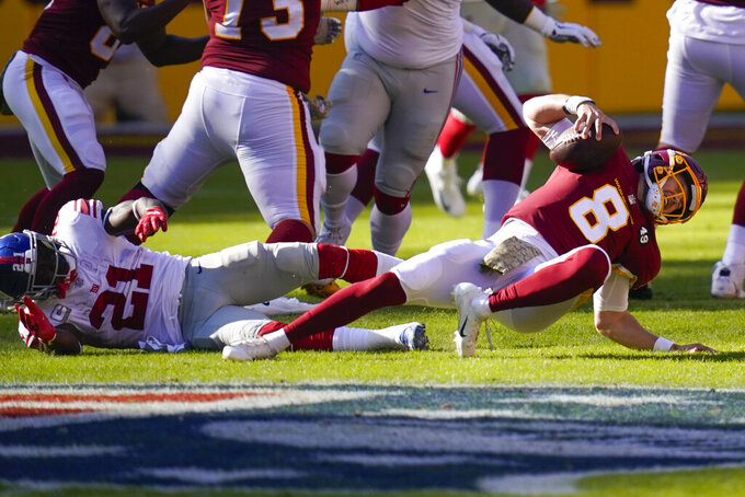 Washington Football Team quarterback Kyle Allen (8) injured his leg in a play against New York Giants strong safety Jabrill Peppers (21) in the first half of an NFL football game, Sunday, Nov. 8, 2020, in Landover, Md. (AP Photo/Patrick Semansky)