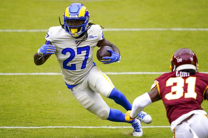 Los Angeles Rams' Darrell Henderson runs during the first half of an NFL football game against the Washington Football Team Sunday, Oct. 11, 2020, in Landover, Md. (AP Photo/Susan Walsh)