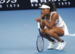 Japan's Naomi Osaka reacts during her third round loss to Coco Gauff of the U.S. at the Australian Open tennis championship in Melbourne, Australia, Friday, Jan. 24, 2020. (AP Photo/Lee Jin-man)