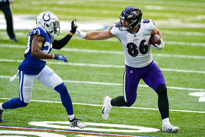 Baltimore Ravens tight end Nick Boyle (86) holds off Indianapolis Colts cornerback Kenny Moore II (23) in the second half of an NFL football game in Indianapolis, Sunday, Nov. 8, 2020. (AP Photo/Darron Cummings)