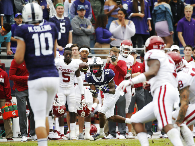 TCU wide receiver KaVontae Turpin (25) catches a pass from TCU quarterback Michael Collins (10) during the first half of an NCAA college football game against Oklahoma, Saturday, Oct. 20, 2018, in Fort Worth, Texas. Oklahoma won 52-27. (AP Photo/Brandon Wade)