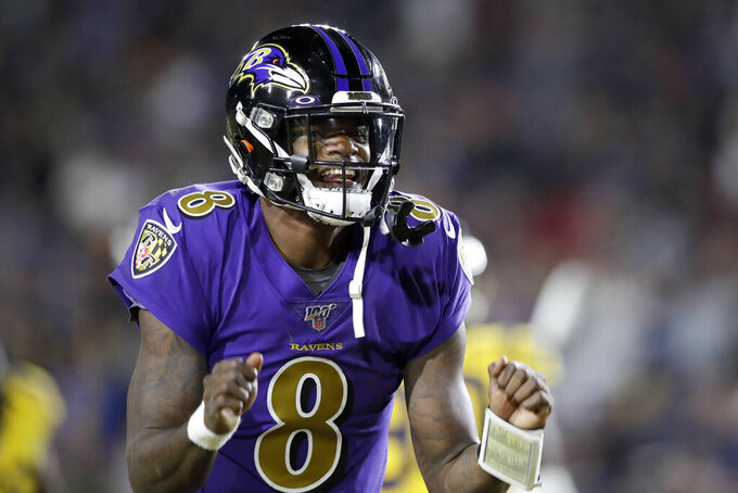 Baltimore Ravens quarterback Lamar Jackson celebrates after throwing a touchdown pass against the Los Angeles Rams during the first half of an NFL football game Monday, Nov. 25, 2019, in Los Angeles. (AP Photo/Marcio Jose Sanchez)