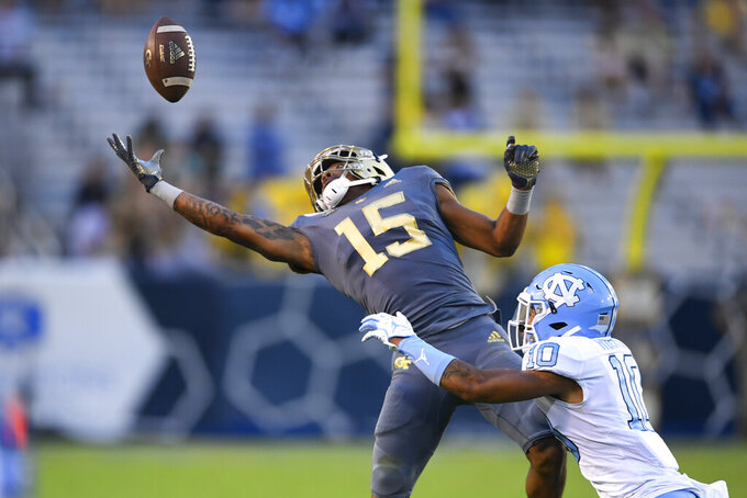 Georgia Tech wide receiver Malachi Carter (15) can't keep hold onto a pass as North Carolina defensive back Greg Ross defends during the second half of an NCAA college football game Saturday, Oct. 5, 2019, in Atlanta. (John Amis/Atlanta Journal-Constitution via AP)