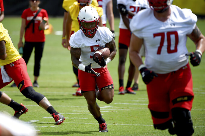 FILE - In this Aug. 2, 2019, file photo, Maryland running back Anthony McFarland (5) works out during an NCAA college football training camp in College Park, Md. Following a miserable 2018 season, the Terrapins start anew Saturday with a home game against neighboring Howard. (AP Photo/Will Newton, File)