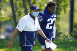 New England Patriots quarterback coach Jedd Fisch, left, and defensive back J.C. Jackson, right, step on the field at the start of an NFL football training camp practice, Sunday, Aug. 23, 2020, in Foxborough, Mass. (AP Photo/Steven Senne, Pool)