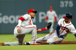 Atlanta Braves' Ender Inciarte (11) steals second base as Philadelphia Phillies shortstop J.P. Crawford (2) applies the late tag in the second inning of a baseball game, Monday, April 16, 2018, in Atlanta. (AP Photo/John Bazemore)