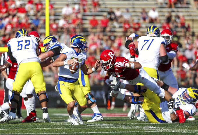Delaware quarterback Nolan Henderson is sacked by Rutgers defensive lineman Aaron Lewis (71) during the first half of an NCAA college football game Saturday, Sept. 18, 2021, in Piscataway, N.J. (Andrew Mills/NJ Advance Media via AP)
