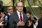 Sen. Mike Braun, R-Ind., speaks to reporters during a recess on Capitol Hill in Washington, Wednesday, Jan. 22, 2020. (AP Photo/Jose Luis Magana)