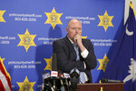 York County Sheriff Kevin Tolson listens as a 911 call is played during a press conference on Thursday, April 8, 2021, in York, S.C. where he addressed the mass shooting by former NFL football player Phillip Adams. (AP Photo/Nell Redmond)