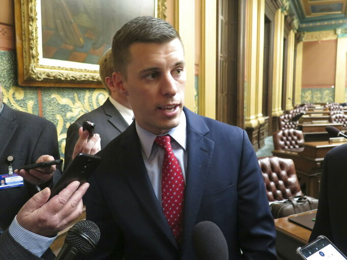 FILE - Michigan House Speaker Lee Chatfield, R-Levering, speaks with reporters following the House's approval of a bill that would cut auto insurance premiums on Thursday, May 9, 2019, in the Capitol in Lansing, Mich. Leaders of six state legislatures in the Big Ten footprint have sent a letter to Commissioner Kevin Warren asking the conference to reconsider its decision to cancel the fall football season. The letter is written on the letterhead of Michigan House Speaker Lee Chatfield. It's also signed by statehouse leaders from Iowa, Minnesota, Ohio, Wisconsin and Pennsylvania. (AP Photo/David Eggert, File)