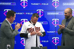 The Minnesota Twins new third baseman Josh Donaldson, flanked by team executive Derek Falvey, left, and manager Rocco Baldelli, puts on a jersey as he is introduced during a baseball news conference Wednesday, Jan. 22, 2020, at Target Field in Minneapolis. (Brian Peterson/Star Tribune via AP)