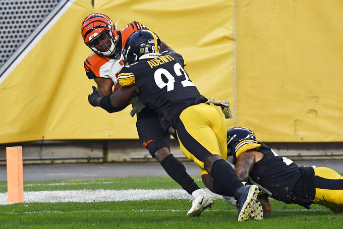 Cincinnati Bengals safety Brandon Wilson (40) is tackled in the end zone by Pittsburgh Steelers linebacker Ola Adeniyi (92) for a touch back during the first half of an NFL football game in Pittsburgh, Sunday, Nov. 15, 2020. (AP Photo/Don Wright)