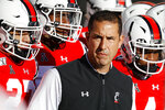 FILE - In this Saturday, Nov. 9, 2019, file photo, Cincinnati head coach Luke Fickell takes the field with his players before the first half of an NCAA college football game against Connecticut, in Cincinnati. The hype surrounding Fickell's team has continued to build since he took over as head coach five years ago.  (AP Photo/John Minchillo, File)