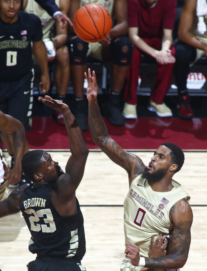 Wake Forest guard Chaundee Brown (23) shoots over Florida State forward Phil Cofer (0) during the first half of an NCAA college basketball game in Tallahassee, Fla., Wednesday, Feb. 13, 2019. (AP Photo/Phil Sears)