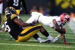Indiana wide receiver D.J. Matthews Jr. (7) is tackled by Iowa linebacker Jestin Jacobs (5) after catching a pass during the second half of an NCAA college football game, Saturday, Sept. 4, 2021, in Iowa City, Iowa. (AP Photo/Charlie Neibergall)