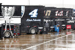 A man watches as rain falls in the infield before a NASCAR Cup Series auto race at Charlotte Motor Speedway Wednesday, May 27, 2020, in Concord, N.C. (AP Photo/Gerry Broome)