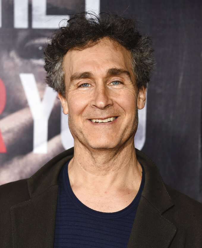 "FILE - Doug Liman attends the premiere of ""A Quiet Place"" on April 2, 2018, in New York. In four months, in the middle of a pandemic and widespread shutdowns, filmmaker Doug Liman and his team wrote, shot and edited a glossy Harrods heist film in London with Anne Hathaway and Chiwetel Ejiofor. The result, ""Locked Down,"" comes to HBO Max Thursday. (Photo by Evan Agostini/Invision/AP, File)"