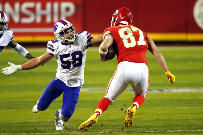 Buffalo Bills linebacker Matt Milano (58) tackles Kansas City Chiefs tight end Travis Kelce (87) during the second half of the AFC championship NFL football game, Sunday, Jan. 24, 2021, in Kansas City, Mo. (AP Photo/Charlie Riedel)