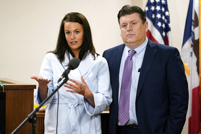 Defense attorneys Jennifer Frese, left, and Chad Frese speak during a news conference after the verdict in the Cristhian Bahena Rivera trial, Friday, May 28, 2021, at the Scott County Courthouse in Davenport, Iowa. A jury on Friday found Bahena Rivera guilty of first-degree murder in the stabbing death of Mollie Tibbetts, a University of Iowa student who vanished while out for a run in 2018. (AP Photo/Charlie Neibergall, Pool)