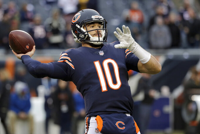 Chicago Bears quarterback Mitchell Trubisky (10) warms up before an NFL wild-card playoff football game against the Philadelphia Eagles Sunday, Jan. 6, 2019, in Chicago. (AP Photo/Nam Y. Huh)