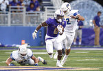 James Madison running back Kaelon Black (6) shakes off the Morehead State defense as he charges up the field during the first half of an NCAA college football game in Harrisonburg, Va., Saturday, Sept. 4, 2021. (Daniel Lin/Daily News-Record via AP)