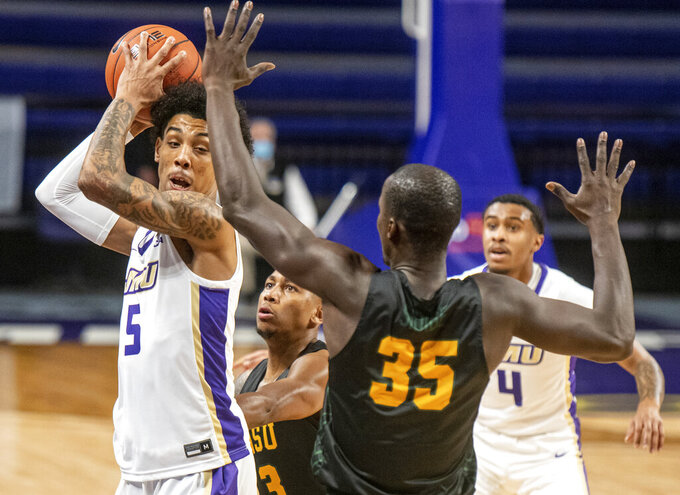 James Madison guard Terrence Edwards (5) gets stuck against the sideline against Norfolk State guards Mustafa Lawrence (3) and Yoro Sidibe (35) during the first half of an NCAA basketball game in Harrisonburg, Va., Friday, Nov. 27, 2020. (Daniel Lin/Daily News-Record via AP)