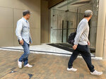 """People walk past a building listed as the address of China Innovation Investment Limited in Hong Kong, Saturday, Nov. 23, 2019. Australia's Treasurer on Saturday labeled detailed accusations of China infiltrating and disrupting democratic systems in Australia, Hong Kong and Taiwan as """"very disturbing."""" A Chinese defector revealed he was part of the Hong Kong-based investment firm, which was a front for the Chinese government to conduct political and economic espionage in Hong Kong, including infiltrating universities and directing bashings and cyber attacks against dissidents. (AP Photo/Ng Han Guan)"""