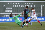 Liverpool goalie Andy Longergan (75) dives to make a save as Sevilla's Ocampos Lucas Ariel (25) tries to score past him and Liverpool's Andy Robertson (26) during the first half of a friendly soccer match at Fenway Park, Sunday, July 21, 2019, in Boston. (AP Photo/Mary Schwalm)