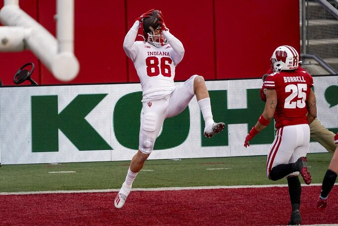 Indiana's Peyton Hendershot catches a touchdown pass during the first half of an NCAA college football game against Wisconsin Saturday, Dec. 5, 2020, in Madison, Wis. (AP Photo/Morry Gash)