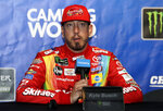 Kyle Busch talks to media during a practice for the NASCAR Sprint Cup Series auto race at Chicagoland Speedway in Joliet, Ill., Saturday, June 29, 2018. (AP Photo/Nam Y. Huh)