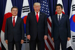 U.S. President Donald Trump meets with Japan's Prime Minister Shinzo Abe, right, and South Korea's President Moon Jae-in before the Northeast Asia Security dinner at the US Consulate General Hamburg, in Hamburg, Germany, July 6, 2017. The latest issuers show South Korea's alliance with the United States looking shaky. Trump complains about the cost of 28,500 U.S. troops stationed in South Korea to protect against North Korean threats. A cost-sharing agreement expired in 2019 and the two sides have failed to agree on a replacement. (AP Photo/Evan Vucci, File)