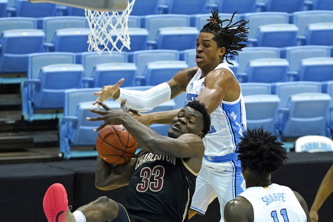 North Carolina forward Armando Bacot and College of Charleston center Osinachi Smart (33) struggle for a rebound during the first half of an NCAA college basketball game in Chapel Hill, N.C., Wednesday, Nov. 25, 2020. (AP Photo/Gerry Broome)