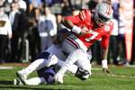 Ohio State quarterback Dwayne Haskins is sacked by Washington linebacker Ryan Bowman during the first half of the Rose Bowl NCAA college football game Tuesday, Jan. 1, 2019, in Pasadena, Calif. (AP Photo/Jae C. Hong)