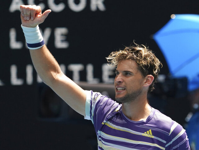 Austria's Dominic Thiem celebrates after defeating France's Gael Monfils in their fourth round singles match at the Australian Open tennis championship in Melbourne, Australia, Monday, Jan. 27, 2020. (AP Photo/Lee Jin-man)