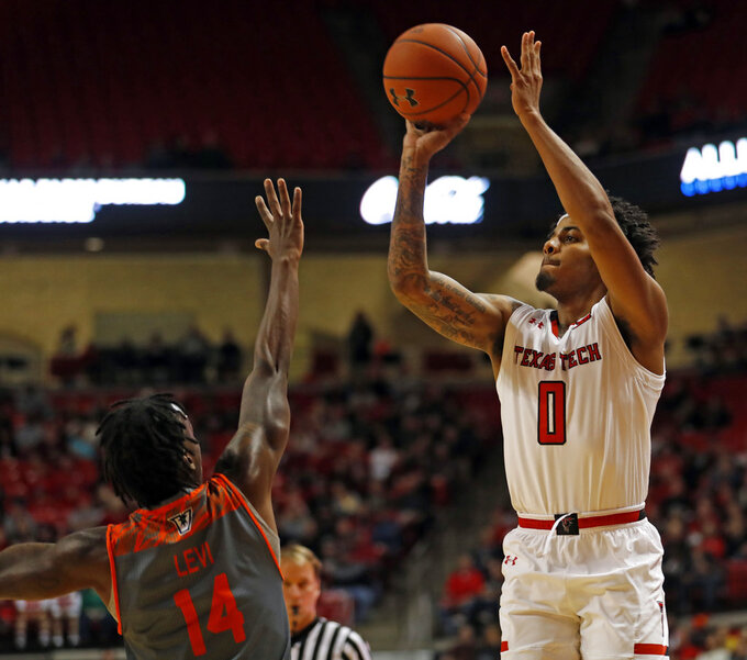Texas Tech's Kyler Edwards (0) shoots over Texas-Rio Grande Valley's Javon Levi (14) during the first half of an NCAA college basketball game Friday, Dec. 28, 2018, in Lubbock, Texas. (AP Photo/Brad Tollefson)